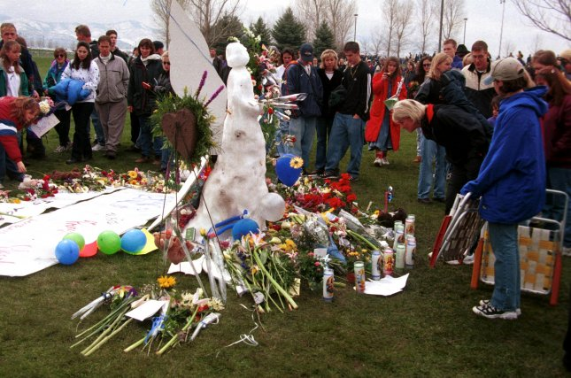 LITTLETON, Colo. -- A group of people gathered around an angel made of snow in Clement Park adjancent to Columbine High School April 25, 1999, in a public outpouring of sympathy. Dylan Klebold and Eric Harris terrorized the school, killing one teacher and 12 students before taking their own lives. Government statistics indicate schools are safer now. RW/jr/Jim Ruymen UPI