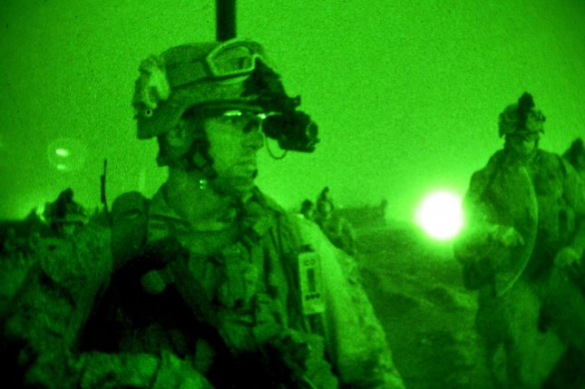 As seen through a night-vision device, U.S. Marines conduct mission rehearsals on Camp Leatherneck in Afghanistan's Helmand province, July 10, 2013. UPI/Cpl. Alejandro Pena/DoD