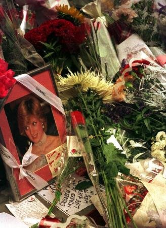Flowers surround a portrait of Princess Diana at a makeshift memorial outside of the British Consulate in New York City Sept. 1, 1997, the day after she was killed in a car crash in France. Diana's funeral on Sept. 6 was televised live around the world. UPI ep/Ezio Petersen