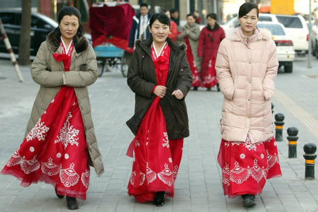 North Korean women in Beijing. Pyongyang is taking a step toward online commerce through the introduction of a website that allows North Koreans to make domestic purchases through the use of a North Korean smart card. File Photo by UPI Photo/Stephen Shaver.
