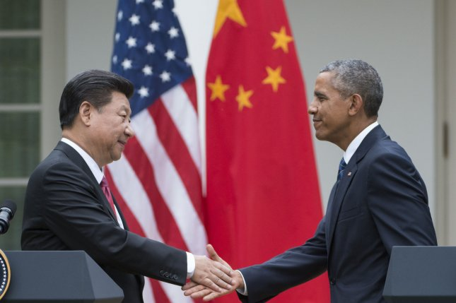 U.S. President Barack Obama and Chinese President Xi Jinping shake hands Sept. 25 after a joint press conference in the Rose Garden of the White House in Washington, D.C. On Monday, in a statement on the Trans-Pacific Partnership agreement, President Obama said other countries should stand up to China's trade practices. Photo by Pat Benic/UPI