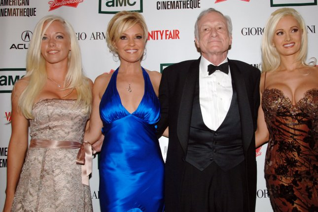 Playboy magazine founder Hugh Hefner and his three live-in girlfriends (L-R) Kendra Wilkinson, Bridget Marquardt and Holly Madison in 2006. The magazine announced it will no longer publish photos of nude women after a redesign in March 2016. (UPI Photo/Jim Ruymen)