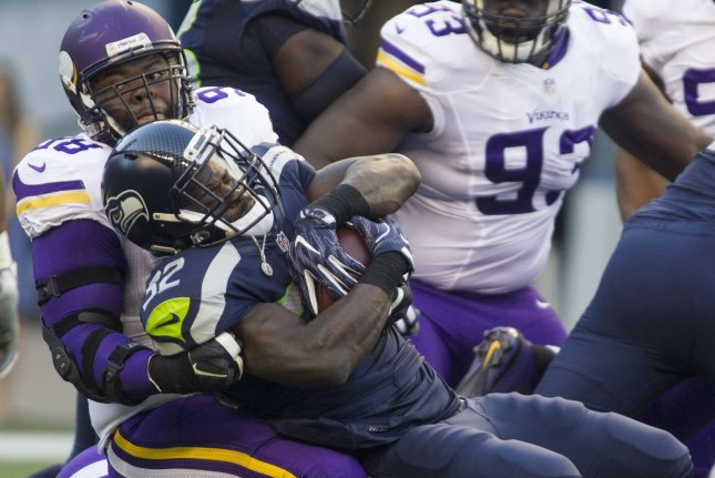 Seattle Seahawks running back Christne Michael (32) is tackled by Minnesota  Vikings defensive tackle Linval Joseph (98) during the first quarter of a  ... e03fab964