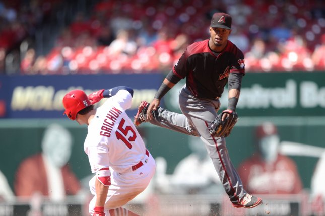 St. Louis Cardinals Randal Grichuk slides into second base with a RBI double as Arizona Diamondbacks Jean Segura jumps for the throw in the ninth inning at Busch Stadium in St. Louis on May 22, 2016. Arizona won the game 7-2. Photo by Bill Greenblatt/UPI