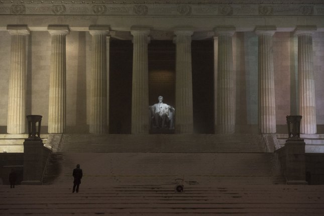 A man visits the Abraham Lincoln Memorial in Washington, D.C. Tuesday, authorities said that the memorial, the Washington Monument and the World War II Memorial were all vandalized with graffiti this week. File Photo by Kevin Dietsch/UPI. Photo by Kevin Dietsch/UPI