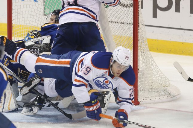 Edmonton Oilers Leon Draisaitl falls over and reaches out for the puck. File photo by BIll Greenblatt/UPI
