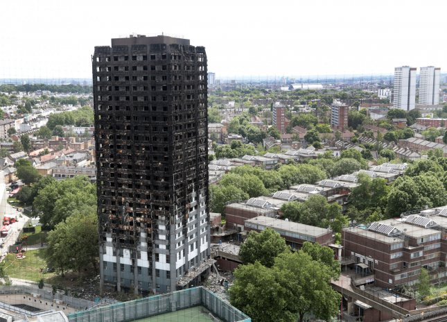 A view shows the total destruction of the 24-story Grenfell Tower building on June 16, 2017. Metropolitan Police Commander Stuart Cundy said Saturday at least 58 people missing from the apartment building have been presumed dead.  Photo by Hugo Philpott/UPI