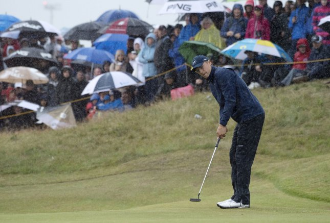 Jordan Spieth putts on the 11th green in the rain on Day Two at the 146th Open Championship at Royal Birkdale Golf Club in Southport, England. Photo by Hugo Philpott/UPI