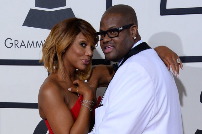 Tamar Braxton (L), pictured with Vincent Herbert, denied her split from Herbert was a ploy for ratings. File Photo by Jim Ruymen/UPI