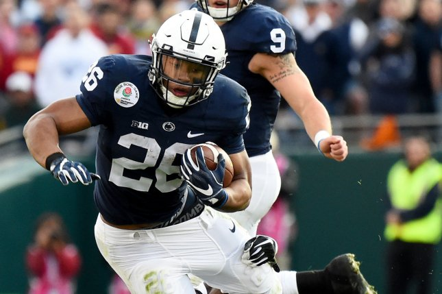 Penn State running back Saquon Barkley (28) is tackled by USC Trojans defender Leon McQuay III (22) during the 2017 Rose Bowl on January 2, 2017 in Pasadena, California. File photo by Juan Ocampo/UPI