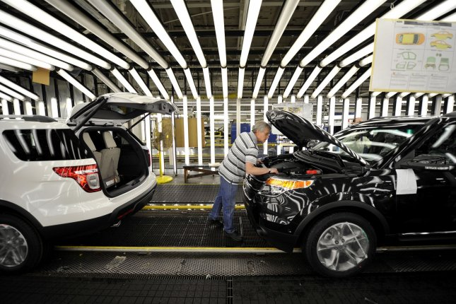 A worker inspects a vehicle as it rolls off the line at Ford's Chicago assembly plant. The plant manufactures the Lincoln MKZ, which was the subject of a safety recall on Wednesday. File Photo by Brian Kersey/UPI