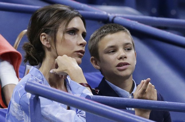 Victoria Beckham (L), pictured with son Romeo, shared a rare photo of her four children Monday. File Photo by John Angelillo/UPI