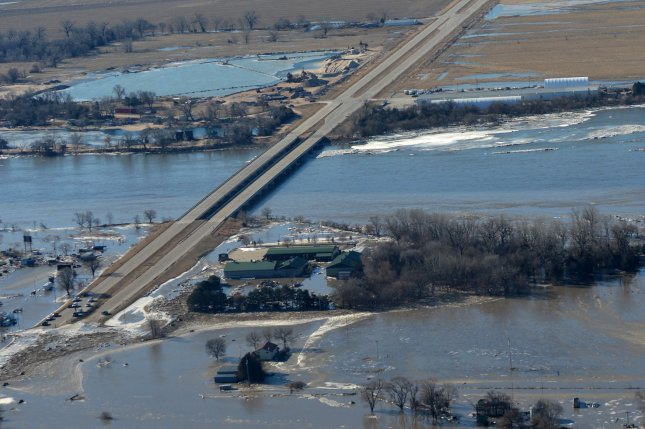 Gov. Pete Ricketts and Maj. Gen. Daryl Bohac, the adjutant general for the Nebraska National Guard, conduct an aerial observation of the historic flooding conditions in portions of northeast Nebraska on March 15. With rain and snow in the forecast, hundreds are being forced to evacuate as a statewide emergency was declared. Photo by Senior Airman Jamie Titus/Nebraska National Guard