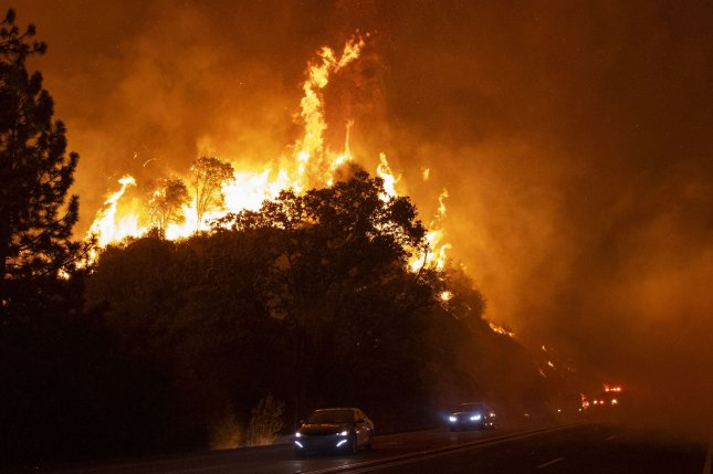 High winds blow embers and flames across Highway 168 as the Creek Fire rapidly expands on Tuesday near Shaver Lake, Calif. Photo by Peter DaSilva/UPI