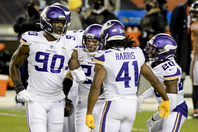 The Minnesota Vikings celebrate Harrison Smith's (22) interception against the Chicago Bears at Soldier Field in Chicago on Monday night. Photo by Mark Black/UPI