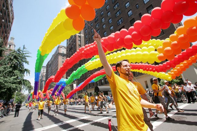 People carry strings of colorful balloons as the Heritage of Pride Parade marches through Greenwich Village. New York failed to make the list of The Advocate's Gayest City in America. (UPI Photo/Monika Graff)