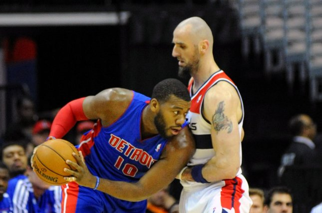 Detroit Pistons power forward Greg Monroe (10) works the ball against Washington Wizards center Marcin Gortat (4) in the first half at the Verizon Center in Washington, D.C. on January 18, 2014. UPI/Mark Goldman
