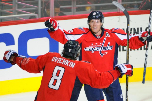 Washington Capitals center Nicklas Backstrom (19) is congratulated by left wing Alex Ovechkin (8) after scoring against the Dallas Stars in the first period at the Verizon Center in Washington, D.C. on November 19, 2015. Photo by Mark Goldman/UPI