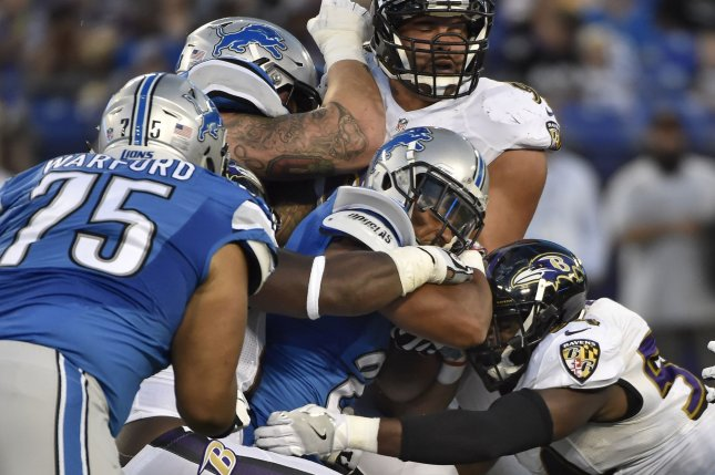 Detroit Lions running back Ameer Abdullah (21) is smothered by Baltimore Ravens defenders during the first half of their NFL preseason game at M&T Bank Stadium in Baltimore, Maryland, August 27, 2016. Photo by David Tulis/UPI