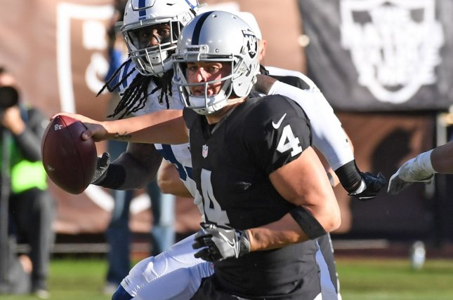 Oakland Raiders QB Derek Carr scrambles against the Indianapolis Colts in the second quarter at the Oakland Coliseum in Oakland, California on December 24, 2016. File photo by Terry Schmitt/UPI