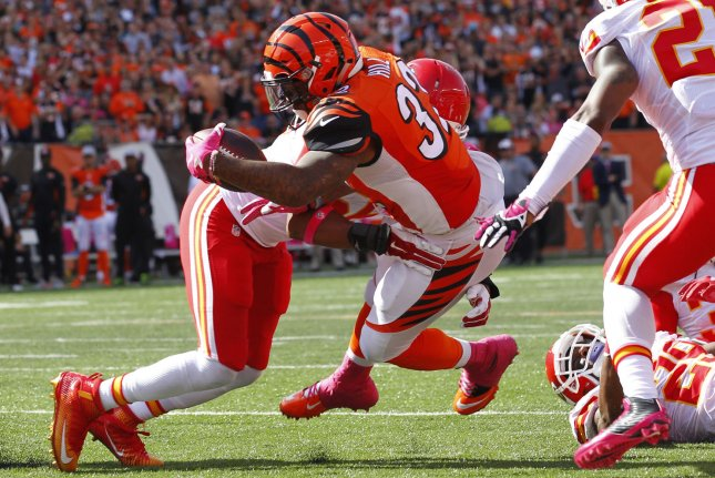 Former Cincinnati Bengals running back Jeremy Hill (32) dives in for the touchdown under pressure from ex-Kansas City Chiefs linebacker Derrick Johnson (56) during the second half of play on October 4, 2015 at Paul Brown Stadium in Cincinnati, Ohio. File photo by John Sommers II/UPI