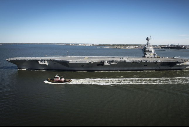 The future USS John F. Kennedy, the second of the Gerald R Ford class of aircraft carriers, will be christened Saturday in Newport News, Virginia. In this photo, the future USS Gerald R. Ford, the first in the Ford ship class, sails on its own power for the first time out of Newport News in 2017. Photo by Ridge Leoni/U.S. Navy
