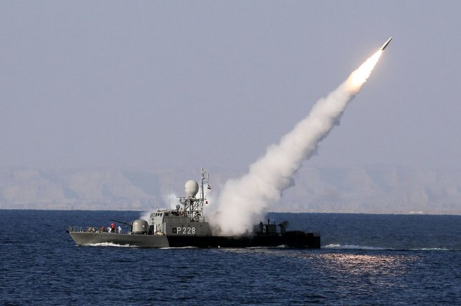 An Iranian navy vessel fires a surface-to-air missile during a military exercise in the Sea of Oman, near the Strait of Hormuz. File Photo by Ali Mohammadi/UPI