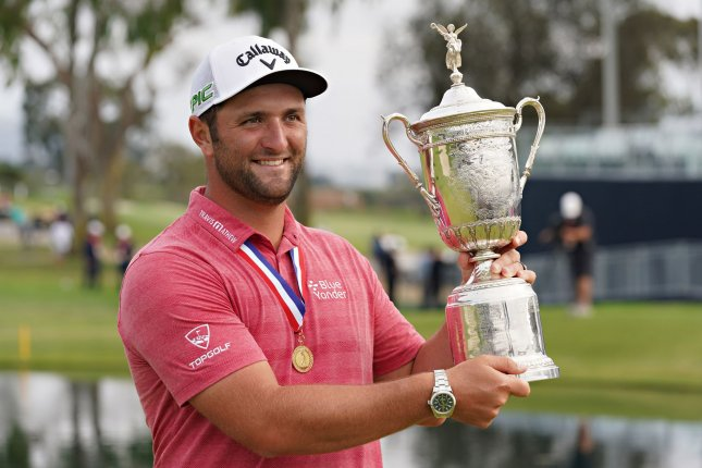 Jon Rahm of Spain holds the trophy after winning the 121st U.S. Open Championship at Torrey Pines Golf Course in San Diego on Sunday. Photo by Richard Ellis/UPI
