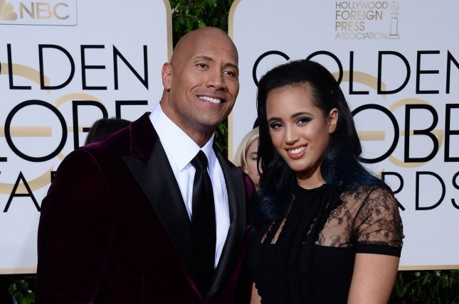 Dwayne Johnson (L) and daughter Simone at the Golden Globe Awards on January 10. The actor plays Bob in Central Intelligence. File Photo by Jim Ruymen/UPI