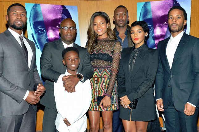 Director Barry Jenkins (second from left) and his cast, from left to right, Trevante Rhodes, Alex Hibbert, Naomie Harris, Mahershala Ali, Janelle Monae and Andre Holland arrive at the Los Angeles premiere of Moonlight on October 13. The film is up for several Golden Globe Awards, which will be handed out Sunday. File Photo by Christine Chew/UPI