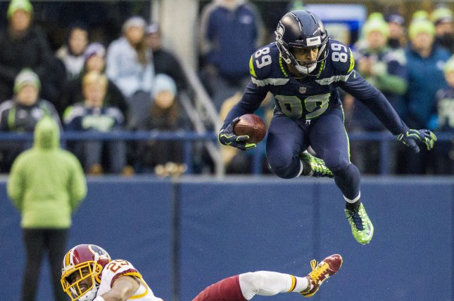 Seattle Seahawks wide receiver Doug Baldwin (89) leaps over the attempted tackle by Washington Redskins cornerback Kendall Fuller (29) for a 7-yard gain during the fourth quarter in their game at CenturyLink Field in Seattle, Washington on November 5, 2017. File photo by Jim Bryant/UPI