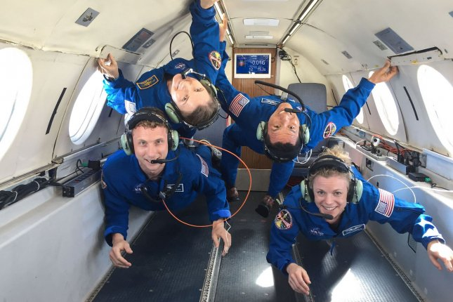 Some of NASA's 2017 astronaut candidates, from left to right: Warren Hoburg, Kayla Barron, Frank Rubio, and Zena Cardman during their reduced gravity flight aboard Canadian Space Agency's Dassault Falcon 20 Jet on February 21, 2018. File Photo by Robert Markowitz/NASA