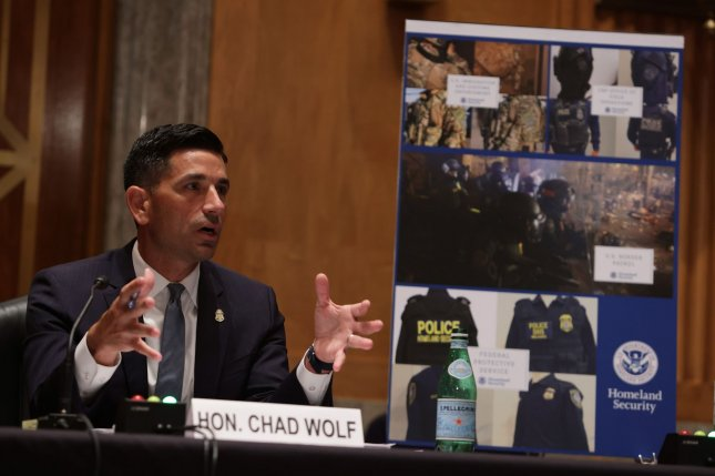 Acting Secretary of Homeland Security Chad Wolf testifies on the use of federal agents during protests in Portland on Aug. 6. On Wednesday, the ACLU sued the Trump administration over the actions of federal agents. Pool Photo by Alex Wong/UPI