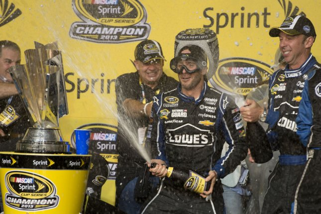 Driver Jimmy Johnson (48) wearing a set of goggles celebrates after winning for the sixth time the NASCAR Sprint Cup Series Championship title at the Homestead-Miami Speedway in Homestead, Florida on November 17, 2013. UPI/Gary I Rothstein
