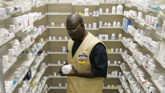 Pharmacy technician fills a prescription at a Wal-Mart store in Chicago. (UPI Photo/Brian Kersey)
