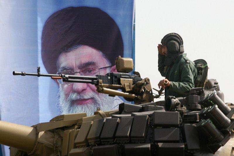 An Iranian soldier salutes in front of a placard of Iran's Supreme Leader Ayatollah Ali Khamenei during a military parade on September 22,2009 in Tehran, Iran marking the beginning of the 1980-1988 Iran-Iraq war. UPI/Maryam Rahmanian