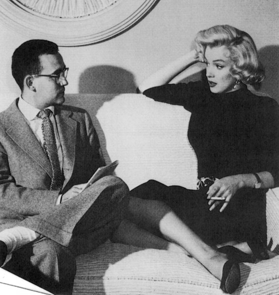 Actress Marilyn Monroe is see in this undated photograph being interviewed by Vernon Scott, Hollywood reporter for United Press International. UPI File Photo