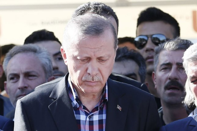Turkish President Recep Tayyip Erdogan attends the funeral of the victims of the coup attempt in Istanbul in Turkey on Friday. Erdogan said Monday he's ready to reinstate the death penalty if the people demand it. Photo by Cem Turkel/UPI