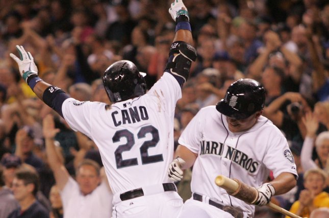 Seattle Mariners' Robinson Cano (22) and Kyle Seager bump one another after a home run. File photo by Jim Bryant/UPI