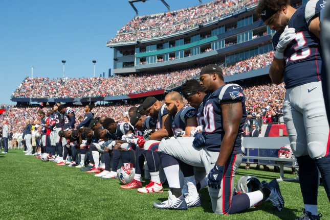 Numerous New England Patriots players take a knee during the playing of the national anthem prior to the game against the Houston Texans at Gillette Stadium in Foxborough, Massachusetts on September 24, 2017. Photo by Matthew Healey/ UPI