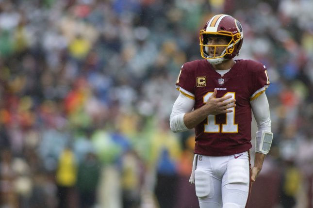 Washington Redskins quarterback Alex Smith (11) pats his chest after throwing an incomplete pass against the Green Bay Packers on September 23 at FedEx Field in Landover, Md. Photo by Alex Edelman/UPI