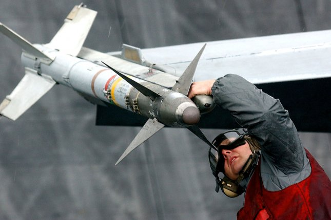 An ordnance handler on the flight deck of the aircraft carrier USS Harry S. Truman checks a Sidewinder missile on a F-18 Hornet. Raytheon Missile Systems received a $434 million contract for modifications and ancillary equipment of the AIM-9X Sidewinder missiles, the Defense Department announced Friday. File Photo by John Gillis/UPI