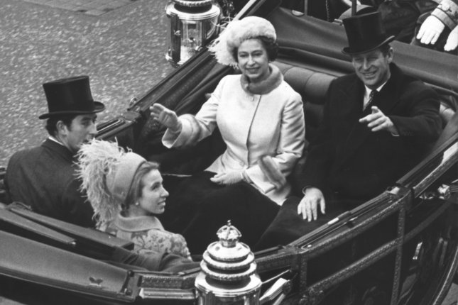 Queen Elizabeth II and Prince Philip wave to crowds as they are driven from Buckingham Palace to Guildhall in London in November 1972. Tuesday's letters showed that the queen had no direct hand in dismissing Australian Prime Minister Gough Whitlam three years later. UPI Photo/British Information Services/File