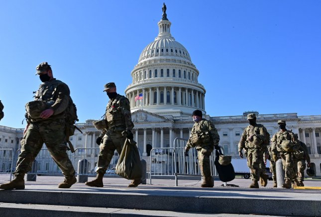 Military personnel patrol near the U.S. Capitol on Thursday. Photo by David Tulis/UPI