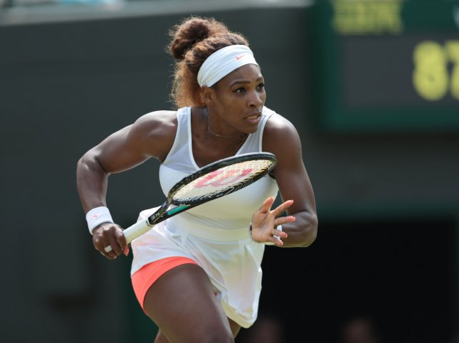 American Serena Williams runs for a ball in her match against Caroline Garcia on day four of the 2013 Wimbledon Championships in London on June 26, 2013. UPI/Hugo Philpott
