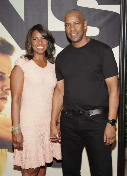 Pauletta Washington and Denzel Washington arrive on the red carpet at the world premiere of 2 Guns at the SVA Theater in New York City on July 29, 2013. UPI/John Angelillo