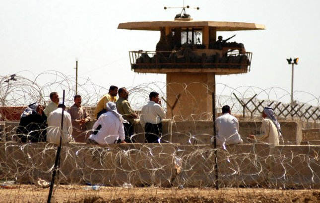 Hundreds of Iraqis gather outside of Abu Ghraib prison in Baghdad on May 4, 2004, looking for information about their relatives. (UPI Photo/Hugo Infante)