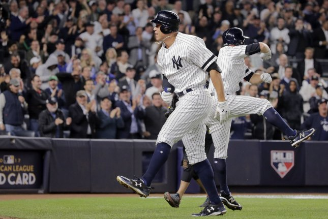 New York Yankees batter Aaron Judge celebrates his two-run home run against the Minnesota Twins with runner Brett Gardner (R) in the fourth inning of the 2017 MLB Playoffs American League Wild Card Game at Yankee Stadium in New York City on October 3, 2017. The winner advances to play the Cleveland Indians in the ALDS. Photo by Ray Stubblebine/UPI