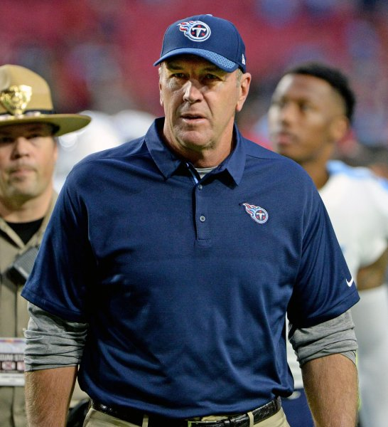Tennessee Titans interim coach Mike Mularkey leaves the field after Sunday's loss to the Arizona Cardinals. Photo by Art Foxall/UPI