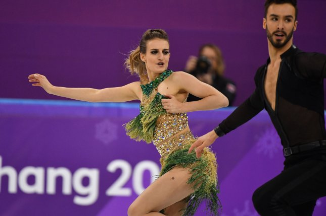 French ice dancer who suffered wardrobe malfunction leaves with silver medal
